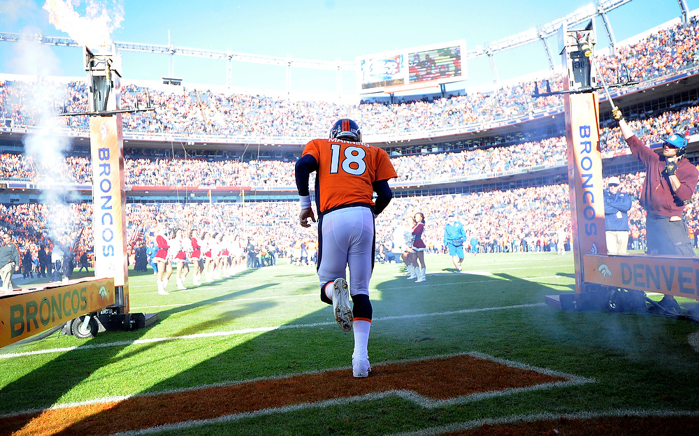. Denver Broncos quarterback Peyton Manning (18) heads on to the field prior to the game against the Cleveland Browns at Sports Authority Field on Sunday December 23, 2012. John Leyba, The Denver Post