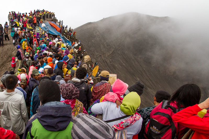 The summit of Mt Bromo is crowded on Yadnya Kasada as thousands of people gather to make their offerings to the volcano god. The smoke from the crater can sometimes be overwhelming.