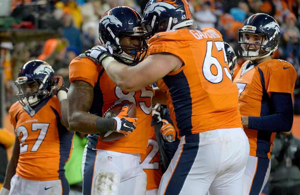 . DENVER, CO - DECEMBER 28: Virgil Green (85) of the Denver Broncos celebrates his first career touchdown with Ben Garland (63) during the fourth quarter. The Denver Broncos played the Oakland Raiders at Sports Authority Field at Mile High in Denver on December, 28 2014. (Photo by Joe Amon/The Denver Post)