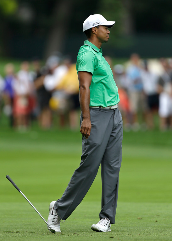 . Tiger Woods reacts after hitting on the eighth fairway during the second round of the PGA Championship golf tournament at Oak Hill Country Club, Friday, Aug. 9, 2013, in Pittsford, N.Y. (AP Photo/Julio Cortez)