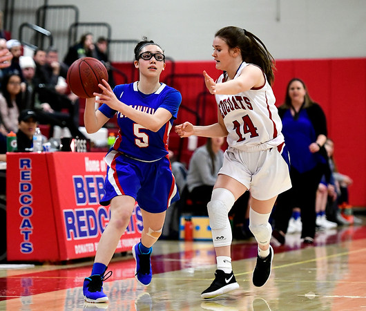 2/26/2019 Mike Orazzi | Staff Plainvilles Jaida Vasquez (5) and Berlin's Angela Perrelli (14) during the CIAC 2019 State Girls Basketball Tournament at Berlin High School Tuesday night.