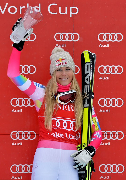. Lindsey Vonn of the US celebrates on the podium after winning the second women\'s downhill race during the Alpine Skiing FIS World Cup at Lake Louise, Canada on December 6, 2014.           AFP PHOTO/Mark  RALSTON/AFP/Getty Images