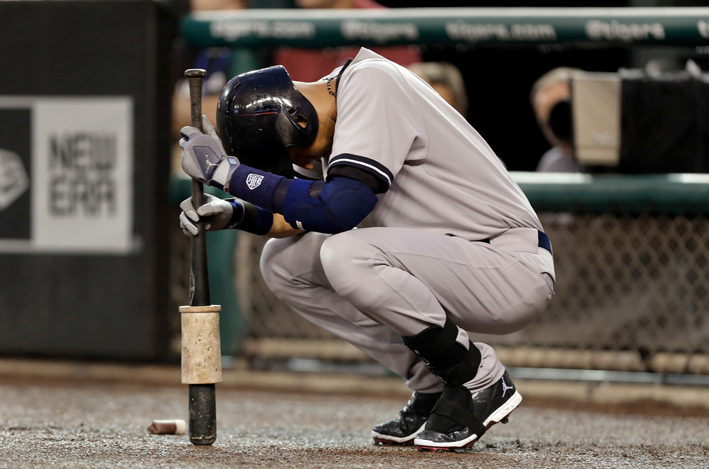 . New York Yankees\' Derek Jeter pauses before batting against the Detroit Tigers in the first inning of a baseball game in Detroit Tuesday, Aug. 26, 2014. (AP Photo/Paul Sancya)