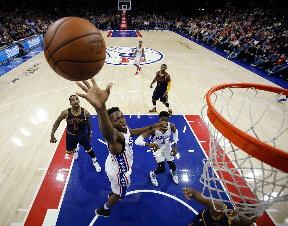. Philadelphia 76ers\' Jerami Grant goes up for a shot during the first half of an NBA basketball game against the Cleveland Cavaliers, Sunday, Jan. 10, 2016, in Philadelphia. (AP Photo/Matt Slocum)