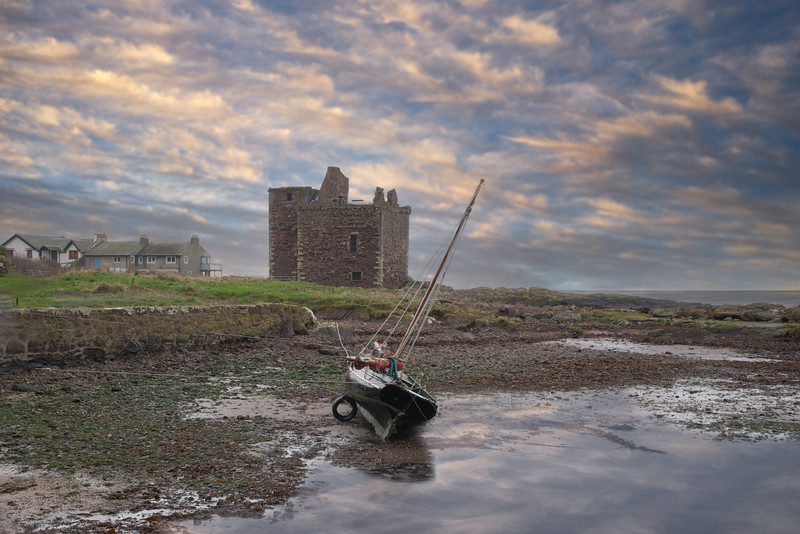 The Old Ruins at Portencross  and a Stranded Boat at Low Tide.