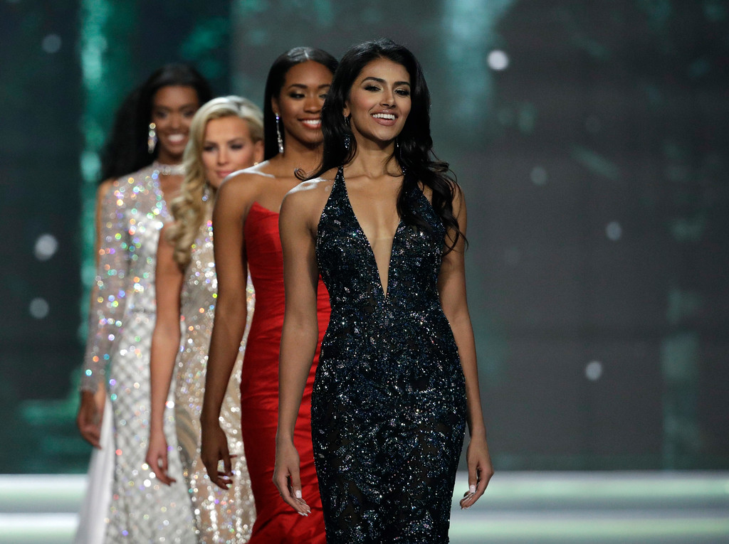 . Miss New Jersey USA Chhavi Verg walks up the stage during the Miss USA contest Sunday, May 14, 2017, in Las Vegas. (AP Photo/John Locher)