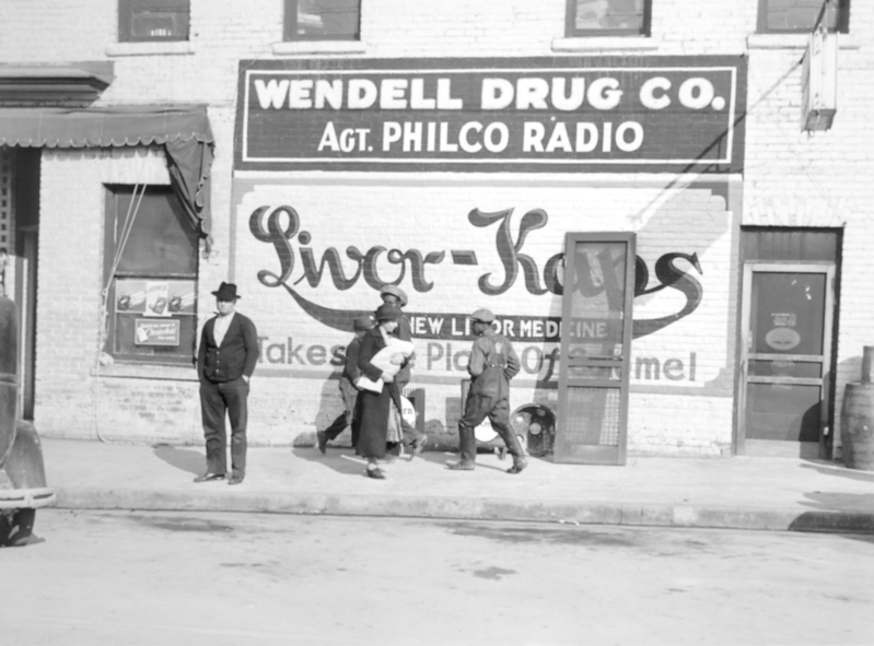 "Marion Post Wolcott, ""Advertisement on the Side of a Drug Store"" (1939)"
