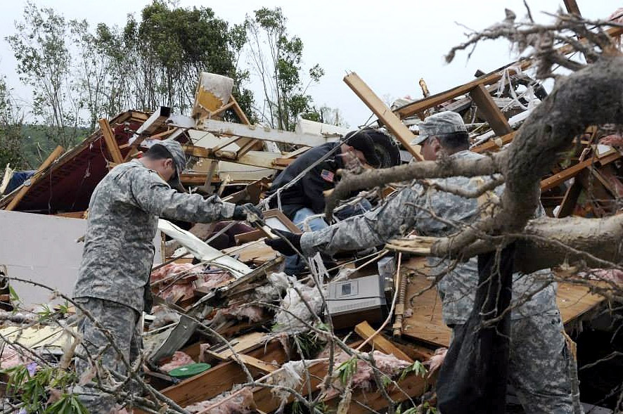 . In this handout provided by the Arkansas National Guard, Arkansas National Guardsmen from the Conway based Special Troops Battalion, 39th Infantry Brigade Combat Team assist a family salvage heirlooms amongst the debris following a deadly tornado April 28, 2014 in Mayflower, Arkansas. Arkansas National Guard members continue to respond to emergency declared disaster areas within the state of Arkansas. At least 11 people were killed Monday after a tornadoes touched down in Alabama, Mississippi and Tennessee, bringing the overall death toll from two days of severe weather to at least 28.  (Photo by Arkansas National Guard via Getty Images)