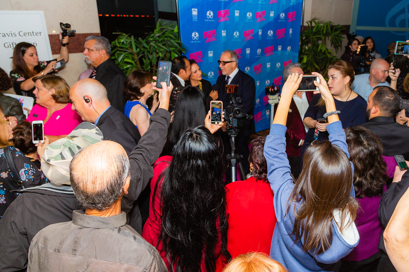 """Gloria and Emilio Estefan talk to the media before the opening of their musical """"ON YOUR FEET!"""" (The story of Emilio and Gloria Estefan) at the Kravis Center in West Palm Beach on Tuesday, January 8, 2019, while a crowd of fans tries to get pictures with their cellphones.. [JOSEPH FORZANO/palmbeachdailynews.com]"""