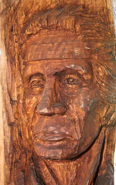 Closeup of, part of a Totem Pole carved by Steve Mount from Terre Haute, IN., at the Pioneer Days festival, in Fowler Park, near Terre Haute.
