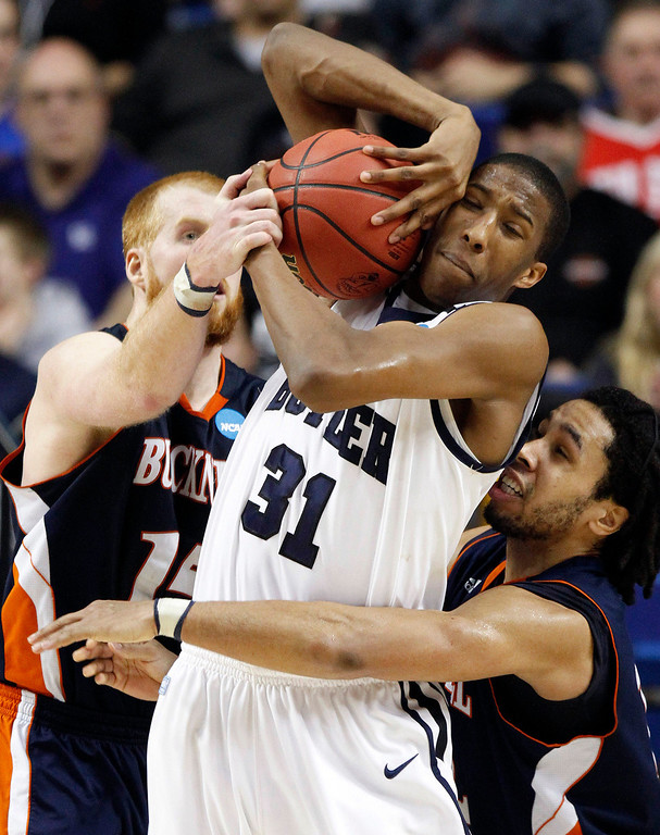 . Butler forward Kameron Woods (31) wrestles with Bucknell\'s Joe Willman, left, and Bryson Johnson, right, for a rebound during the second half of their second-round game in the NCAA college basketball tournament Thursday, March 21, 2013, in Lexington, Ky. Butler won 68-56. (AP Photo/James Crisp)