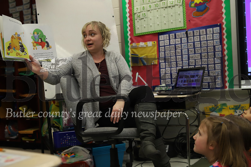 McQuistion Elementary teacher Rene Ruffner reads a story about moms to inspire her students to write Mother's Day letters. Seb Foltz/Butler Eagle