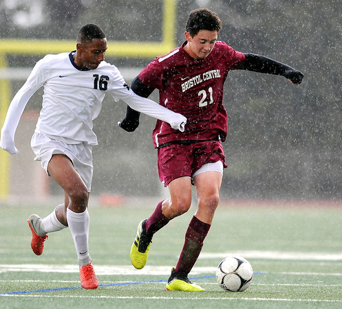 10/17/2018 Mike Orazzi | Staff Newington's Asland Tate (16) and Bristol Central's Carson Rivoira (21) during boys soccer at BC Wednesday afternoon.