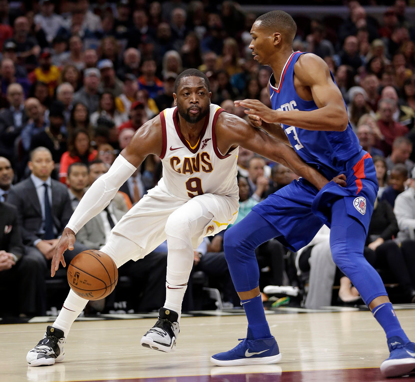 . Cleveland Cavaliers\' Dwyane Wade (9) drives around Los Angeles Clippers\' Wesley Johnson (33) during the first half of an NBA basketball game, Friday, Nov. 17, 2017, in Cleveland. (AP Photo/Tony Dejak)