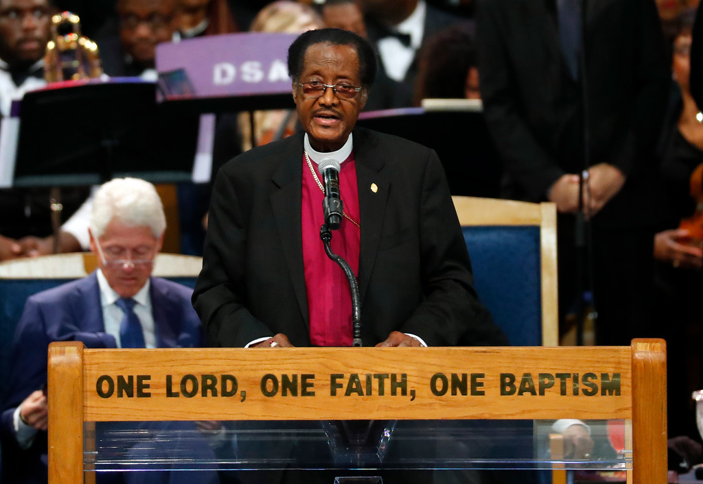 . Bishop P.A. Brooks speaks during the funeral service for Aretha Franklin at Greater Grace Temple, Friday, Aug. 31, 2018, in Detroit. Franklin died Aug. 16, 2018 of pancreatic cancer at the age of 76. (AP Photo/Paul Sancya)