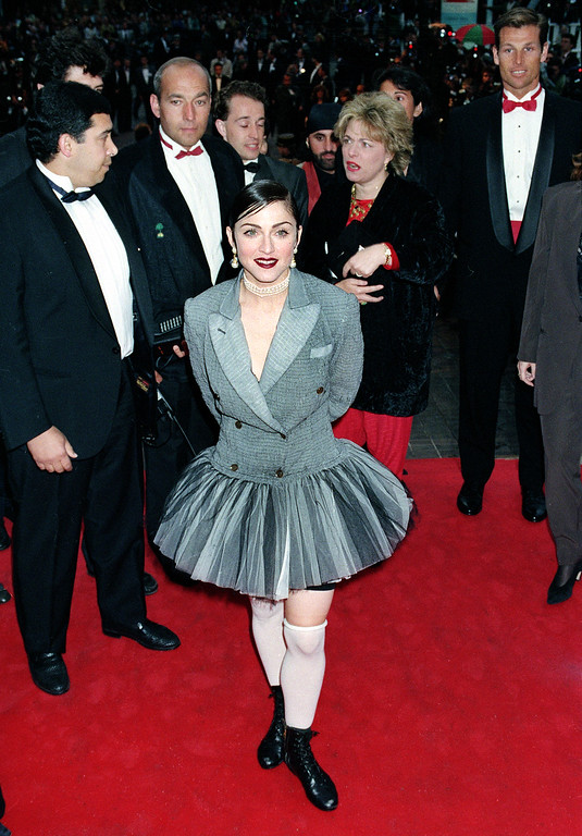 ". American singer-actress Madonna makes an unexpected appearance at the movie screening of ""Jungle Fever\"" at the Cannes Film Festival in Cannes, France, May 16, 1991.  (AP Photo/Jose Goitia)"