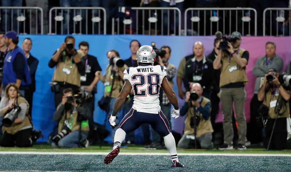 . New England Patriots\' James White celebrates his touchdown run during the first half of the NFL Super Bowl 52 football game against the Philadelphia Eagles Sunday, Feb. 4, 2018, in Minneapolis. (AP Photo/Matt York)