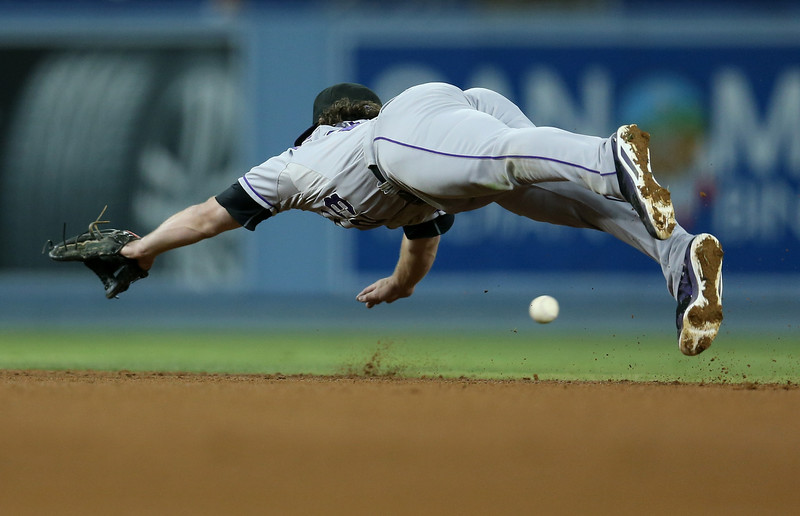 . Second baseman  Charlie Culberson #23 of the Colorado Rockies dives but can\'t reach a single hit by Joc Peterson of the Los Angeles Dodgers in the sixth inning at Dodger Stadium on September 27, 2014 in Los Angeles, California.  (Photo by Stephen Dunn/Getty Images)