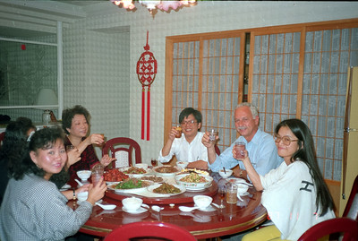 Henry Fan's mom and other family members sitting down to a wonderful home cooked Chinese dinner in Taipei.