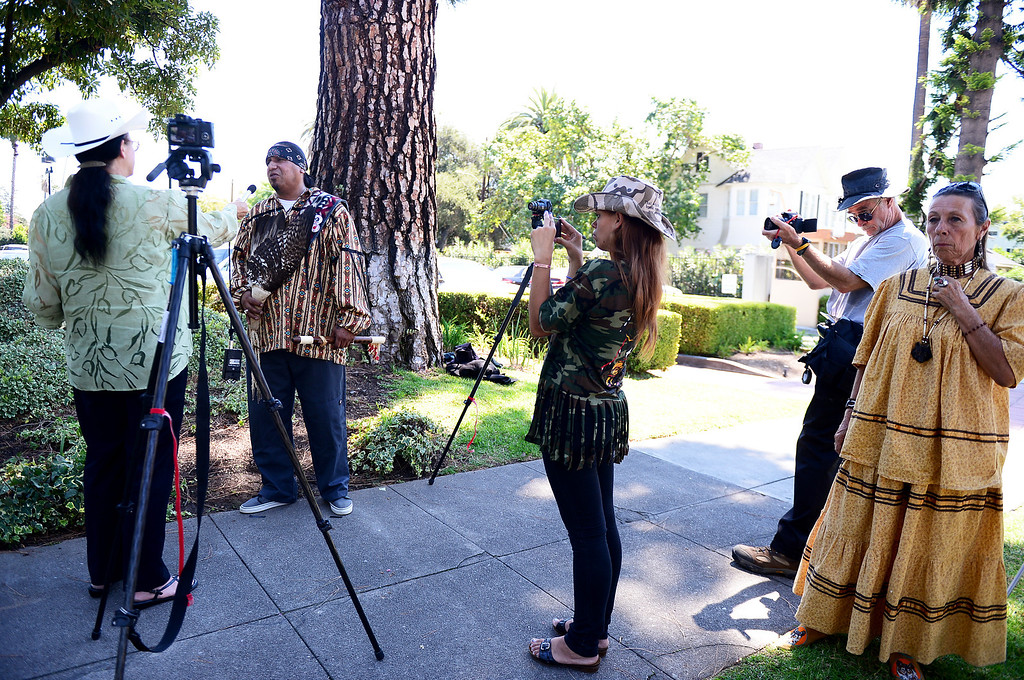. Wildlife activists are interviewed by media as they gather outside the Ninth Circuit Court of Appeals in Pasadena before attending a hearing on Bureau of Land Management\'s round-up of wild horses Thursday, August 29, 2013.  (Photo by Sarah Reingewirtz/Pasadena Star-News)
