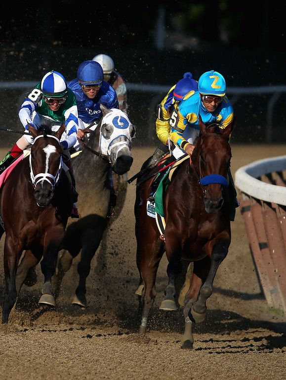 . American Pharoah #5, ridden by Victor Espinoza, leads the pack during the 147th running of the Belmont Stakes at Belmont Park on June 6, 2015 in Elmont, New York. With the win American Pharoah becomes the first horse to win the Triple Crown in 37 years.  (Photo by Streeter Lecka/Getty Images)