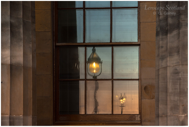 Lamp reflection in window of Royal Scottish Academy