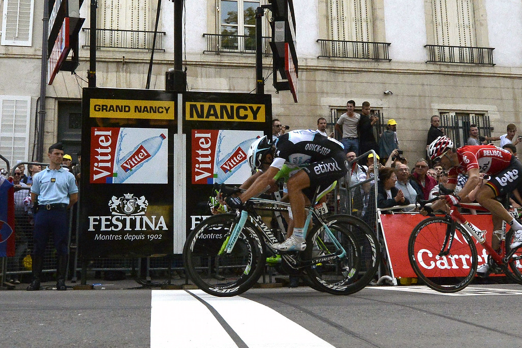 . Italy\'s Matteo Trentin (front) crosses the finish line ahead of Slovakia\'s Peter Sagan (hidden) wearing the best sprinter\'s green jersey, and wins the 234.5 km seventh stage of the 101st edition of the Tour de France cycling race on July 11, 2014 between Epernay and Nancy, northeastern France.  AFP PHOTO / ALIX GUIGON/AFP/Getty Images