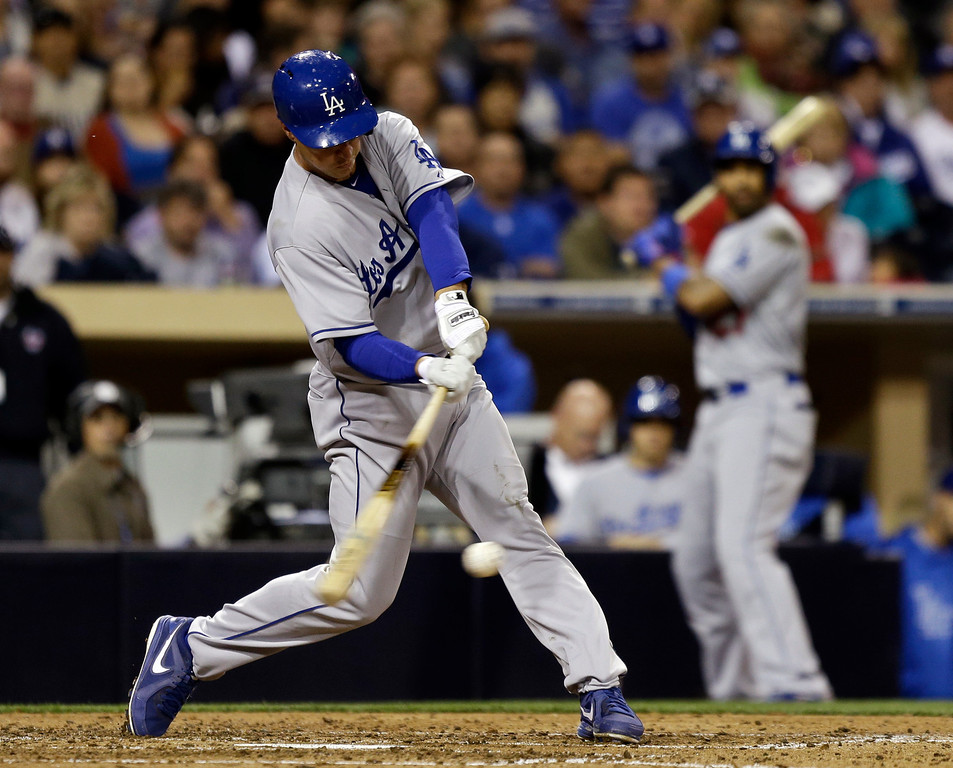 . Los Angeles Dodgers\' Mark Ellis hits an RBI single against the San Diego Padres to drive in Carl Crawford from third during the fifth inning of a baseball game in San Diego, Wednesday, April 10, 2013. (AP Photo/Lenny Ignelzi)