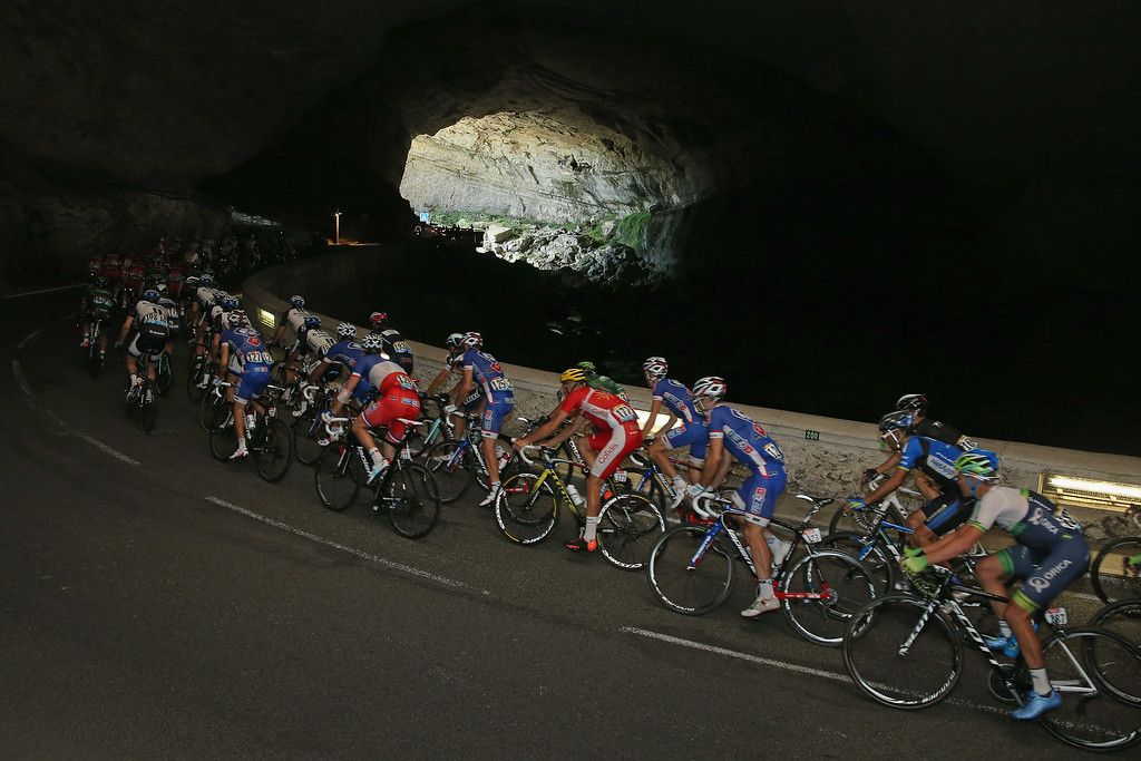 . The peloton passes through a cave during the sixteenth stage of the 2014 Tour de France, a 238km stage between Carcassonne and Bagneres-de-Luchon, on July 22, 2014 in Maury, France.  (Photo by Doug Pensinger/Getty Images)