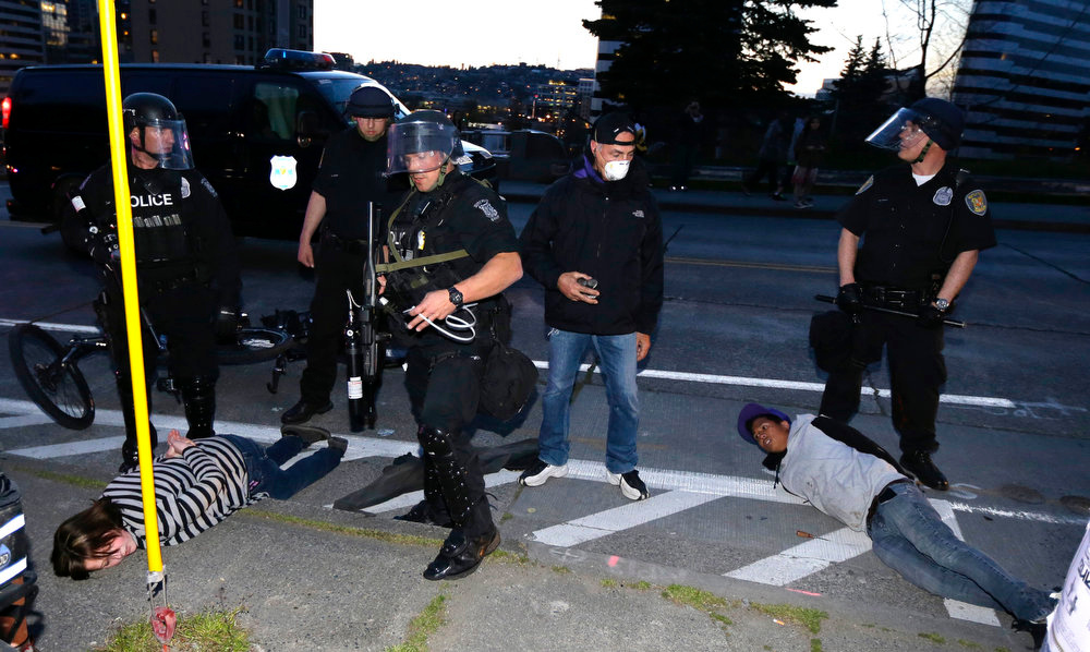 . Protesters are detained by police during a May Day march that began as an anti-capitalism protest and turned into demonstrators clashing with police, Wednesday, May 1, 2013, in downtown Seattle. (AP Photo/Ted S. Warren)