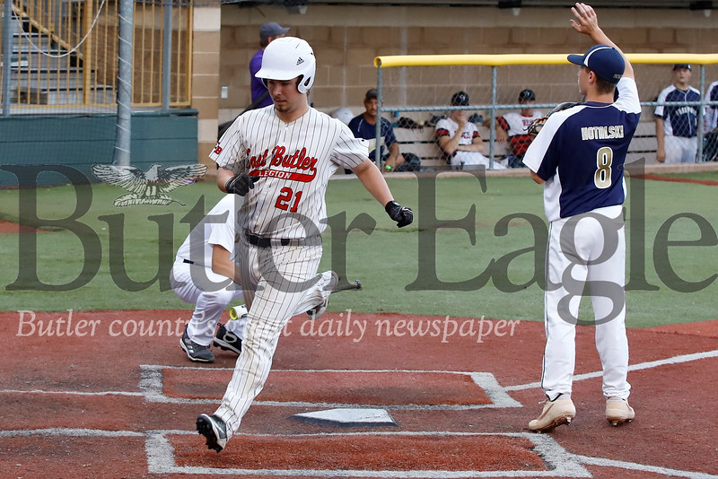 Hunter Green crosses home to score for the National League in the Butler County Area Baseball League All Star game Monday night. Seb Foltz/Butler Eagle