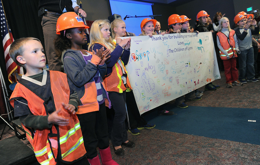 . LONGMONT, CO - OCTOBER 29:   Children from Lyons Elementary School hold up a sign they made for members of the military during the celebration  at the Life Bridge Community Church in  Longmont, Co on October 29, 2013.  They were attending at the church to  thank members of the military, law enforcement, firefighters and members of Colorado Department of Transportation for all their work during and after the floods.   (Photo By Helen H. Richardson/ The Denver Post)