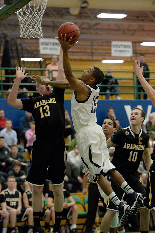 . AURORA, CO - FEBRUARY 12: Overland Austin Conway (15) goes up for a basket on Arapahoe Brendan Till (13) during their 5A basketball game February 12, 2014 in Aurora. Overland defeated Arapahoe 72-65. (Photo by John Leyba/The Denver Post)