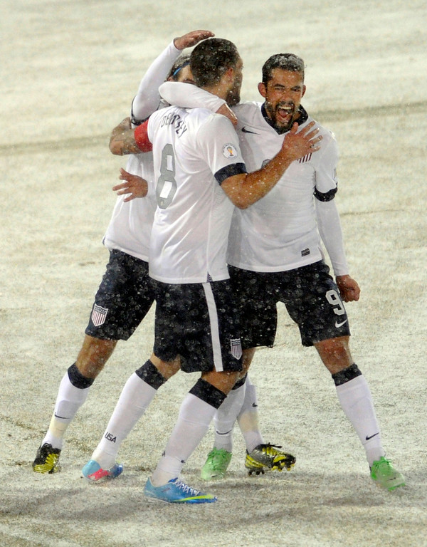 . COMMERCE CITY, CO. - MARCH 22: United States forward Herculez Gomez, right, celebrated with forward Clint Dempsey (8) after his goal in the first half. The U.S. Men\'s National Soccer Team hosted Costa Rica Friday night, March 22, 2013 in a FIFA World Cup qualifier at Dick\'s Sporting Goods Park in Commerce City.  (Photo By Karl Gehring/The Denver Post)