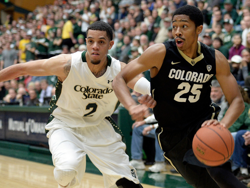 . Colorado\'s Spencer Dinwiddie drives to the hoop past Daniel Bejarano during an NCAA game against CSU on Tuesday, Dec. 3, 2013, at the Moby Arena in Fort Collins. CU won the game 67-62. Jeremy Papasso/ Camera