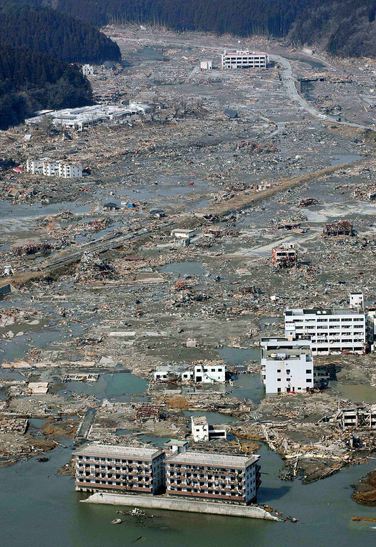 . Rubble is scattered across the wide areas of the town of Minami Sanriku, northeastern Japan, on Sunday March 13, 2011, two days after a powerful earthquake and tsunami hit the the country\'s northeastern coast. (AP Photo/Kyodo News)