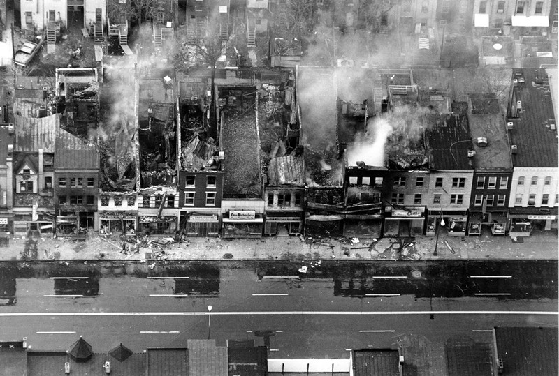 . This aerial photo shows fire-gutted buildings, some still smouldering, along a block on H Street between 12th and 13th Streets in the northeast section of Washington, D.C. on April 5, 1968. Rioting broke out after the assassination of civil rights leader Dr. Martin Luther King, Jr., in Memphis, Tenn. on April 4. (AP Photo)