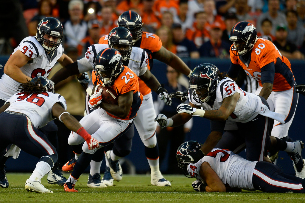. DENVER, CO - AUGUST 23: Ronnie Hillman (23) of the Denver Broncos carries the ball against the Houston Texans during a preseason football game at Sports Authority Field at Mile High on Saturday, August 23, 2014 in Denver, Colorado.  (Photo by Kent Nishimura/The Denver Post)