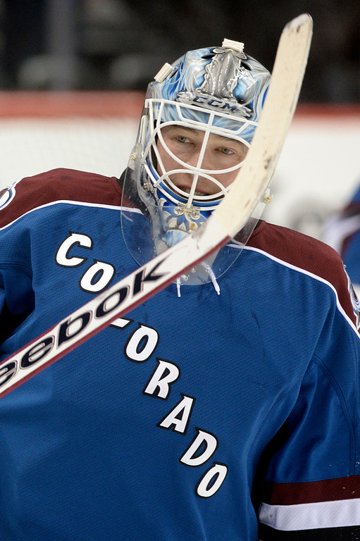 . Avalanche goalie Jean-Sebastien Giguere warmed up before the game. The Colorado Avalanche hosted the Vancouver Canucks Thursday night, March 27, 2014 at the Pepsi Center in Denver, Colorado. (Photo by Karl Gehring/The Denver Post)