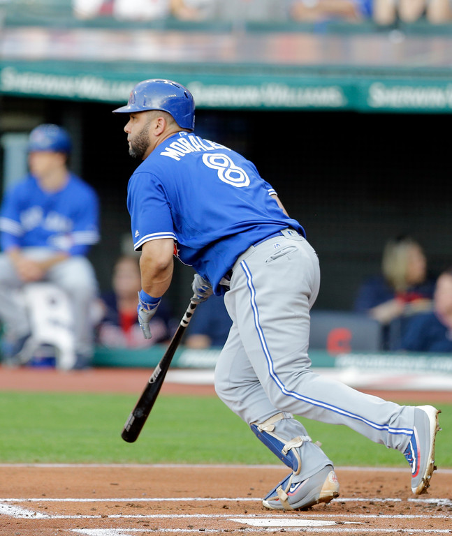 . Toronto Blue Jays\' Kendrys Morales watches his ball after hitting an RBI-single off Cleveland Indians starting pitcher Trevor Bauer in the first inning of a baseball game, Friday, July 21, 2017, in Cleveland. Jose Bautista scored on the play. (AP Photo/Tony Dejak)