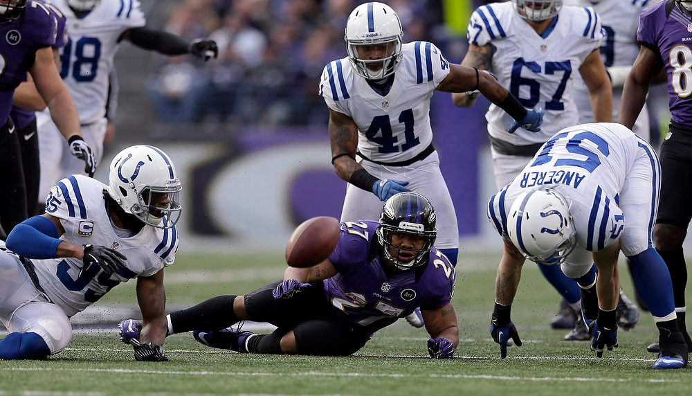Description of . Baltimore Ravens running back Ray Rice (27) watches his fumble bounce away as Indianapolis Colts inside linebacker Pat Angerer (51) moves to make the fumble recovery, during the second half of an NFL wild card playoff football game Sunday, Jan. 6, 2013, in Baltimore. (AP Photo/Patrick Semansky)