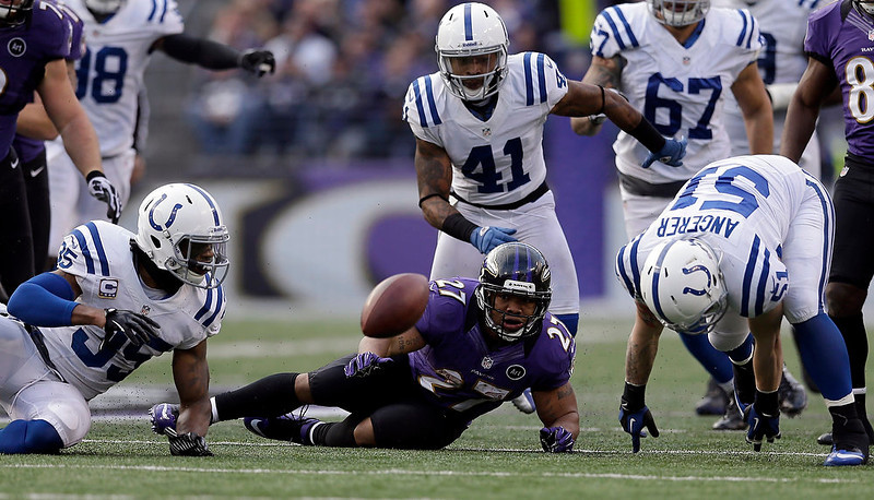 . Baltimore Ravens running back Ray Rice (27) watches his fumble bounce away as Indianapolis Colts inside linebacker Pat Angerer (51) moves to make the fumble recovery, during the second half of an NFL wild card playoff football game Sunday, Jan. 6, 2013, in Baltimore. (AP Photo/Patrick Semansky)