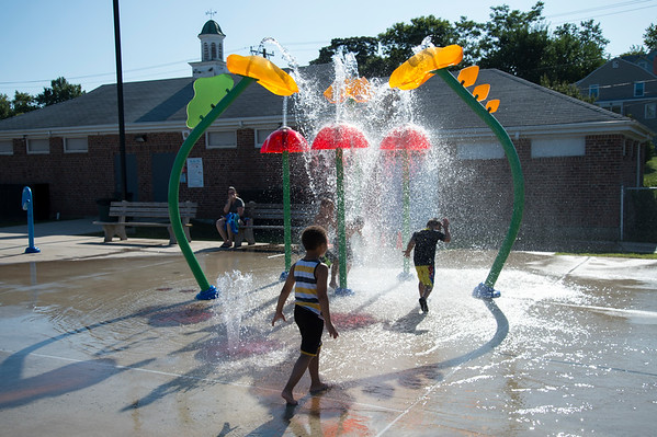 08/20/19 Wesley Bunnell | Staff Children cool down as they play in the splash pad at Chesley Park on Tuesday August 20, 2019.