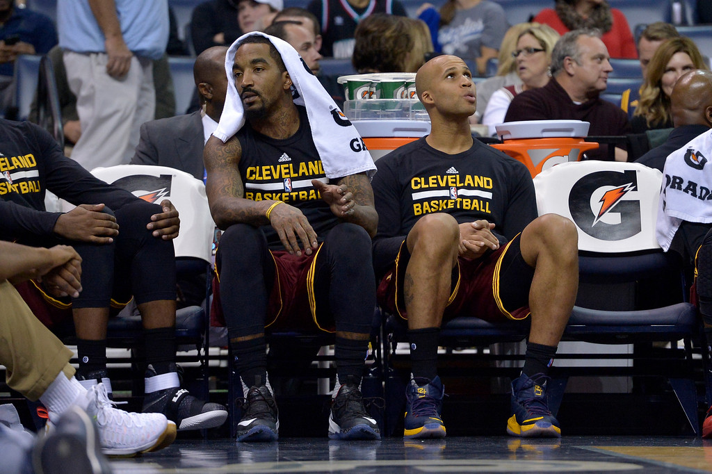 . Cleveland Cavaliers guard J.R. Smith, left, and forward Richard Jefferson (24) sit next to empty chairs on the bench in the second half of an NBA basketball game against the Memphis Grizzlies, Wednesday, Dec. 14, 2016, in Memphis, Tenn. (AP Photo/Brandon Dill)