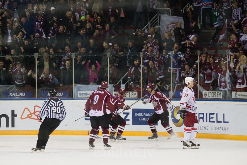 Players of Dinamo Riga celebrate the winning goal in the overtime of the game