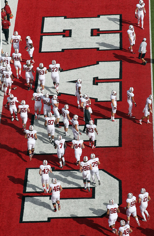 . Members of the Stanford team warm-up before an NCAA college football game against Utah on Saturday, Oct. 12, 2013, in Salt Lake City. (AP Photo/Rick Bowmer)