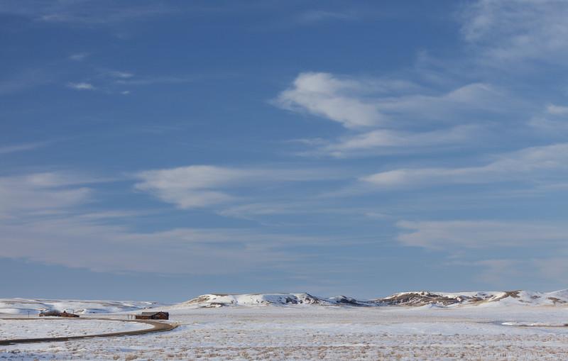 Abandoned homestead and prairie landscape in winter. Grasslands National Park