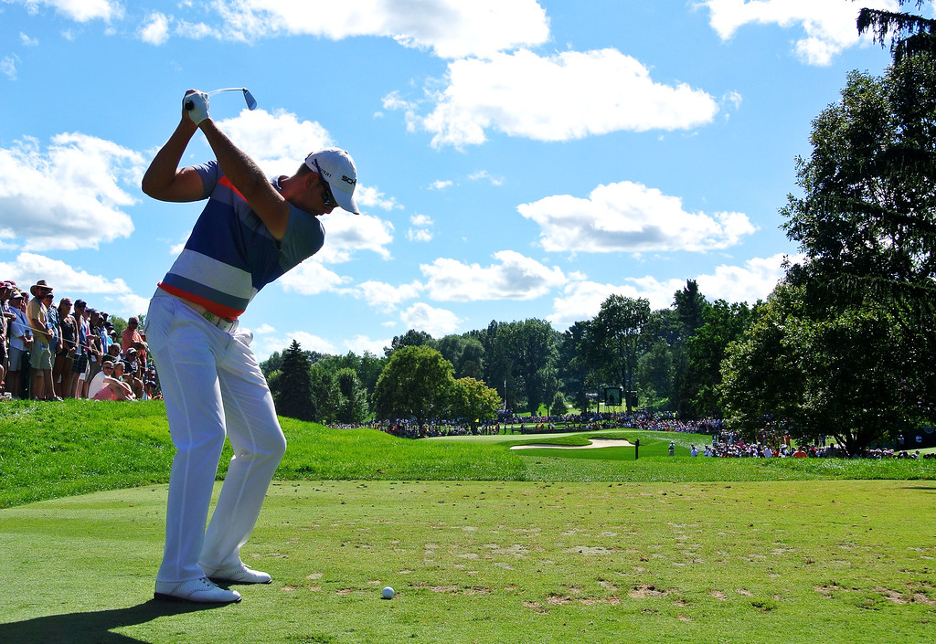 . ROCHESTER, NY - AUGUST 10:  Henrik Stenson of Sweden hits his tee shot on the sixth hole during the third round of the 95th PGA Championship on August 10, 2013 in Rochester, New York.  (Photo by Stuart Franklin/Getty Images)