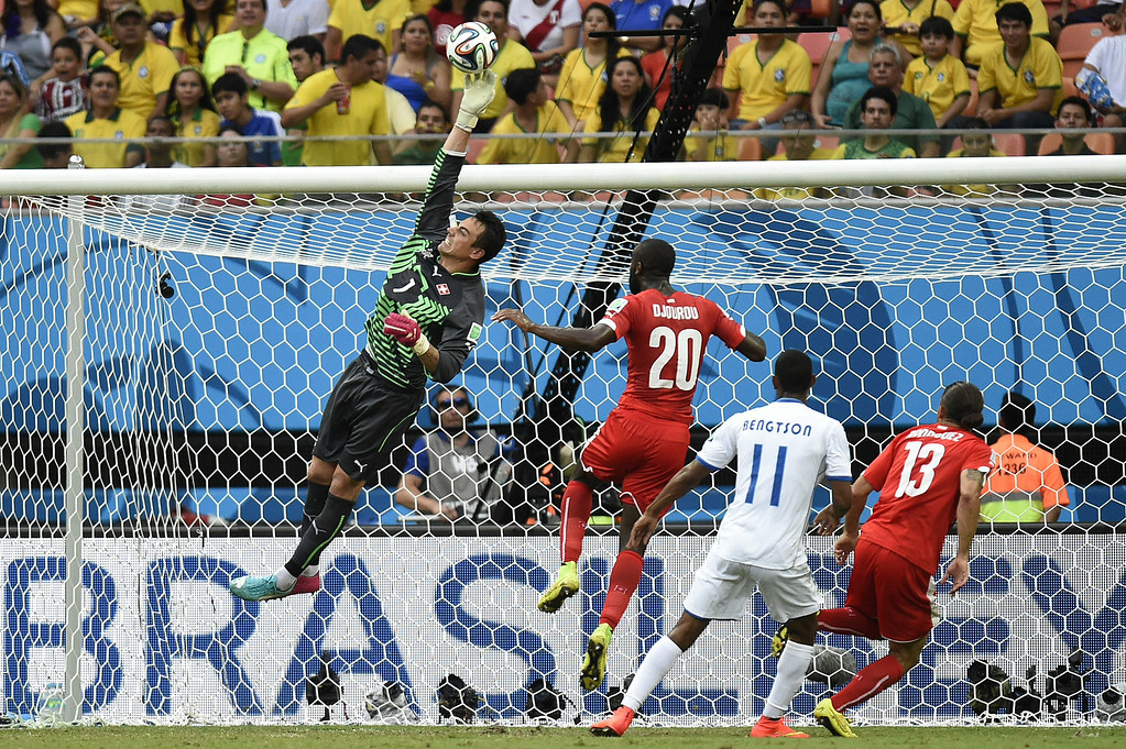 . Switzerland\'s goalkeeper Diego Benaglio (L) punches the ball away during the Group E football match between Honduras and Switzerland at the Amazonia Arena in Manaus during the 2014 FIFA World Cup on June 25, 2014. JUAN BARRETO/AFP/Getty Images