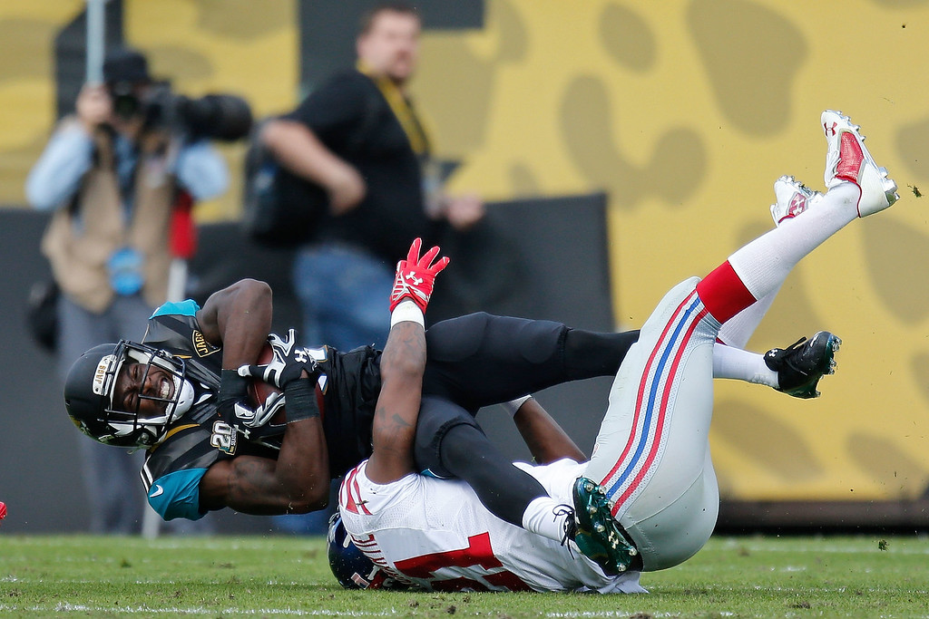 . JACKSONVILLE, FL - NOVEMBER 30: Marqise Lee #11 of the Jacksonville Jaguars is stopped by Dominique Rodgers-Cromartie #21 of the New York Giants during the first half of the game at EverBank Field on November 30, 2014 in Jacksonville, Florida.  (Photo by Rob Foldy/Getty Images)